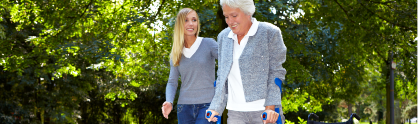 caregiver assisting patient on walking