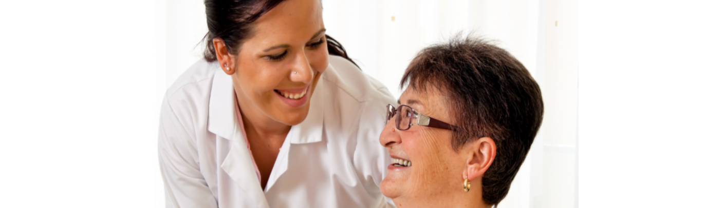 caregiver and patient smiling to each other